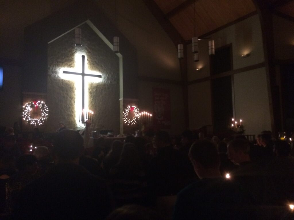 cross lit up at night
