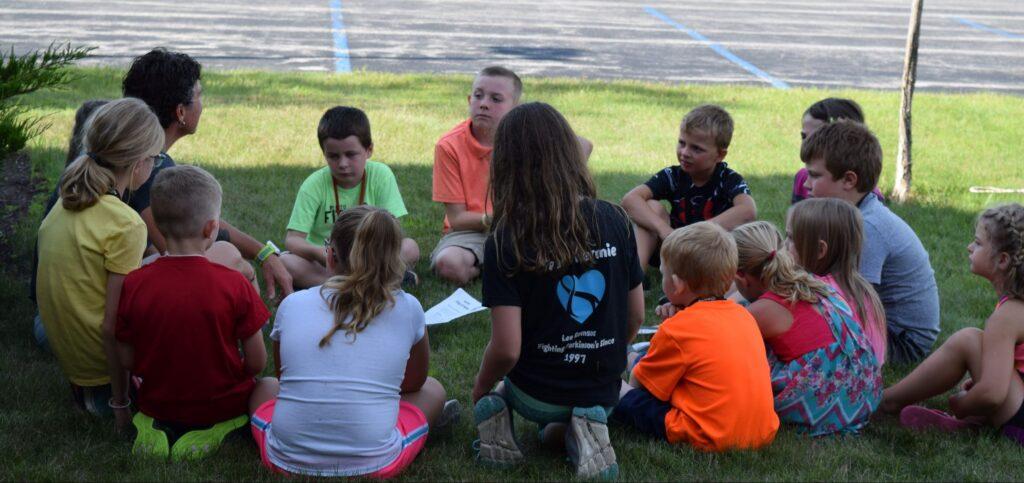 kids sitting outside