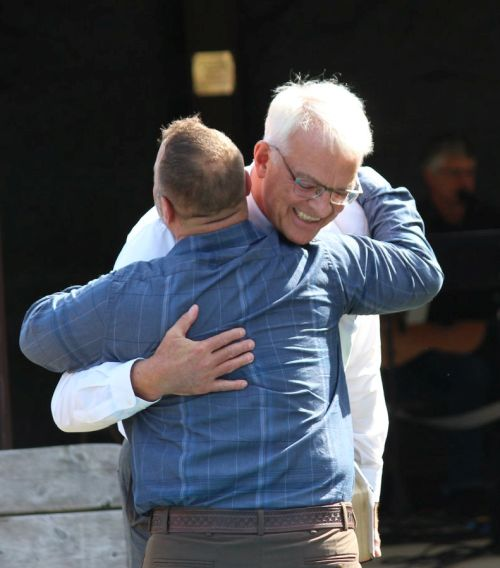 2 men hugging